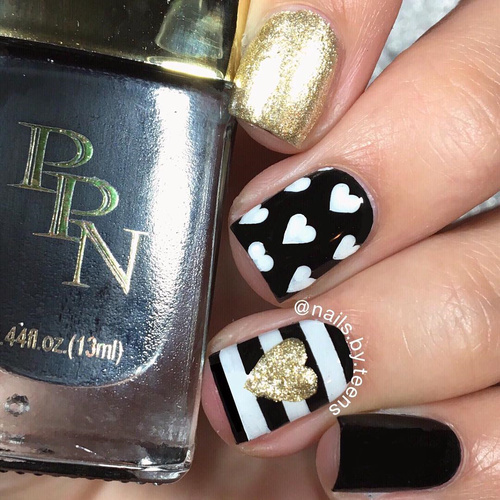 black-and-golden-nailart-with-white-stripes-and hearts