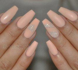 peach-nail-polish-on-long-nails-with-glitter-heart