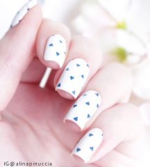 white-naildesign-with-blue-hearts