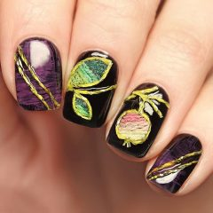 embroided nail design with fruits