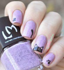 black cat on light purple nails