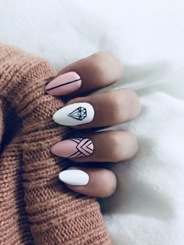 pink and white nails with a diamond