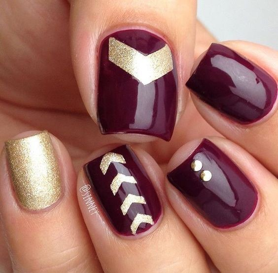 gold and purple-wine nails