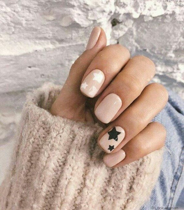 light beige nails with black and white stars