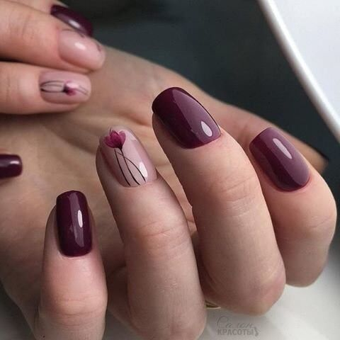 wine colored gel nails with flower design