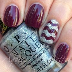dark red nails with glitter zigzag