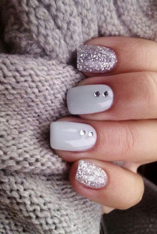 light gray nails with rhinestones and glitter