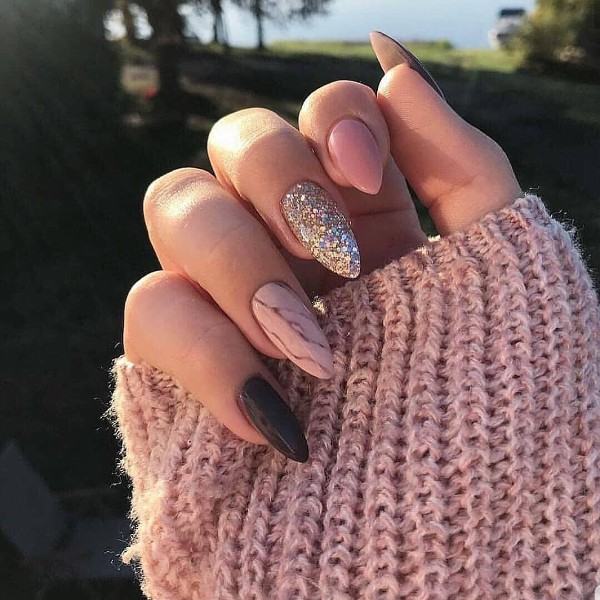 pink and black manicure with a marble accent nail