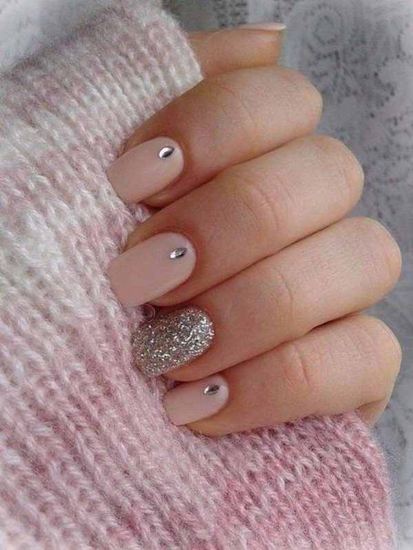 pastel pink design with accent glitter nail