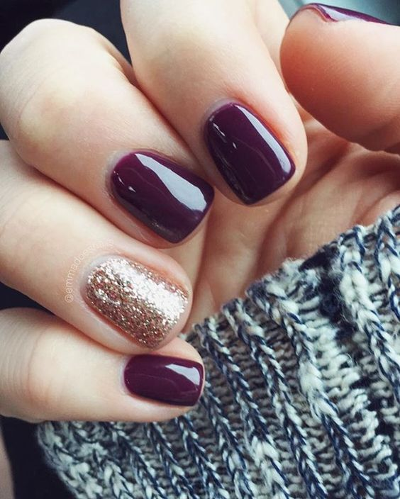 dark wine nails with one glitter accent nail