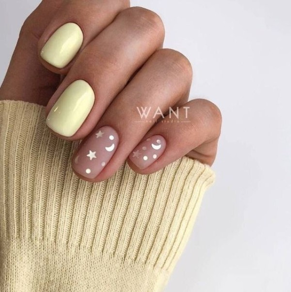 light yellow nail design with stars