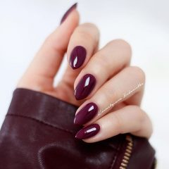 wine red nails with wine red leather jacket