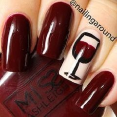 wine themed nail design with a glass of wine