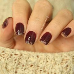 wine nails with golden glitter tips