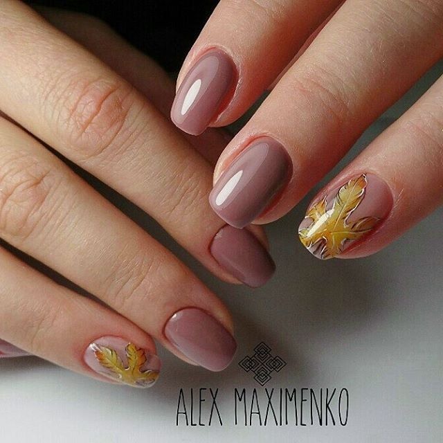nude nail design for autumn with maple leaves