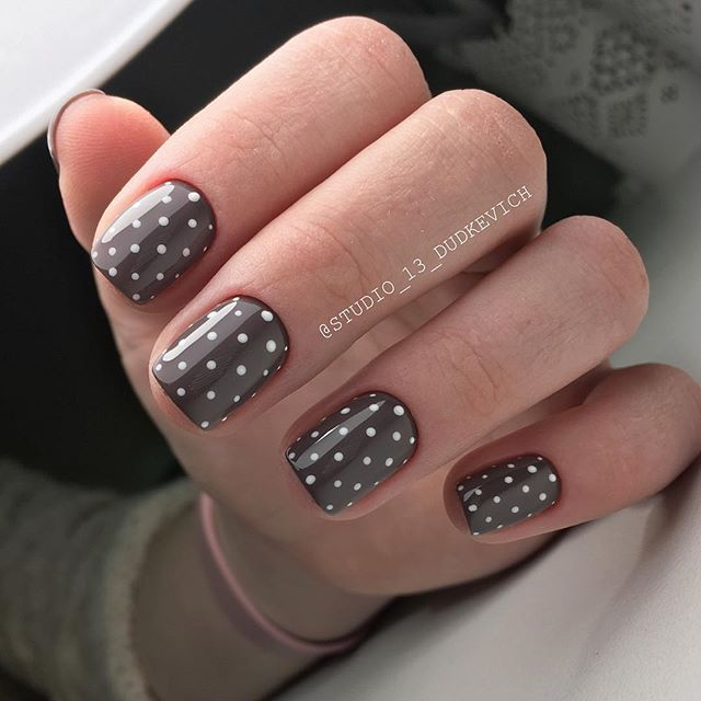 Chocolate brown nail design with white dots