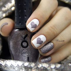 Blue grey and white grainy nail design with hearts