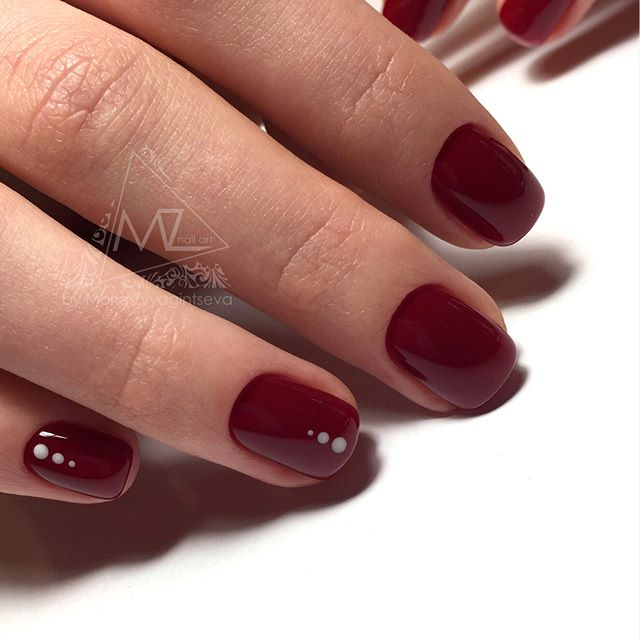 dark red burgundy nails with gold dots