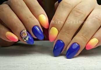 blue and orange nails with candy ball