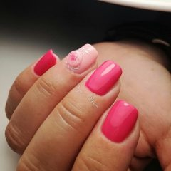 bright pink nails with light pink flower ball
