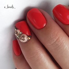 red nail design with candy ball