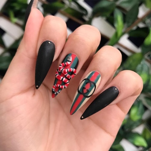 black Gucci nails with a 3D snake