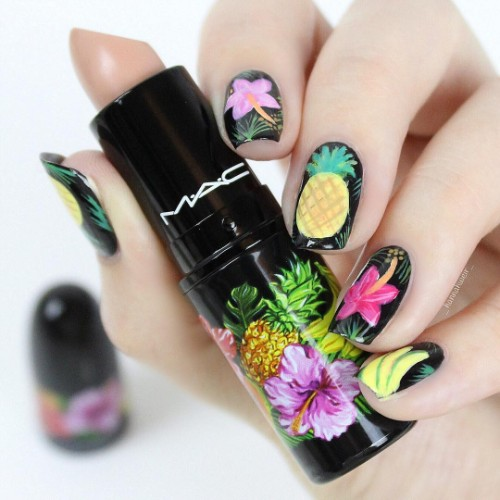 black nails with pineapple and bright flowers