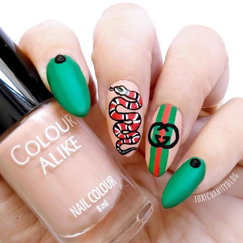 bright green nails with stripes and snake Gucci