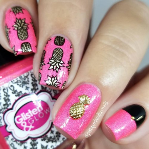 bright pink nails with golden pineapples