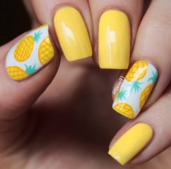 bright yellow pineapple desugn with white accent nails