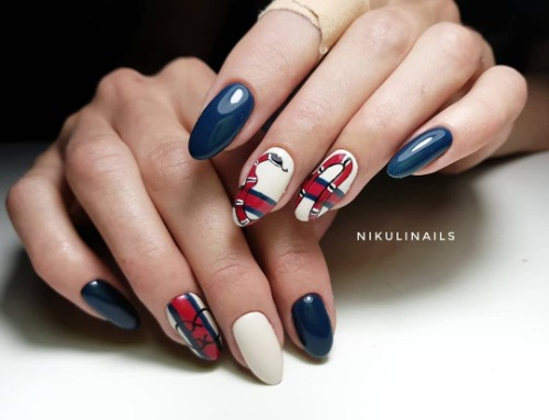 dark blue and white nails with a Gucci red snale