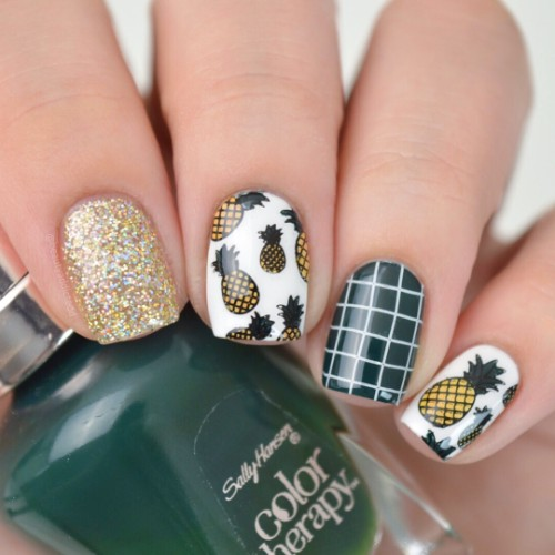 dark green pineapple nail design