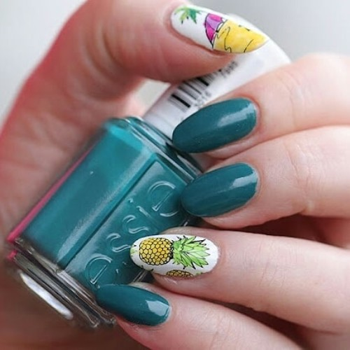 dark green summer nail design with pineapples