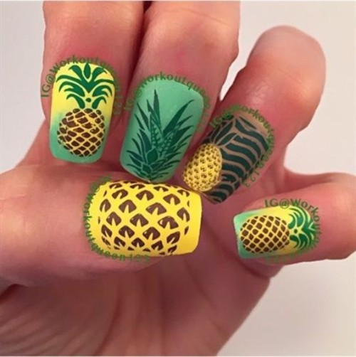 green and yellow nail design with pineapple