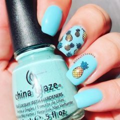 light blue nails with pineapple fruits