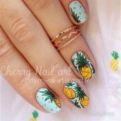 light blue nails with yellow pineapples
