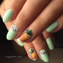 light green nails with pineapples and rhinestones