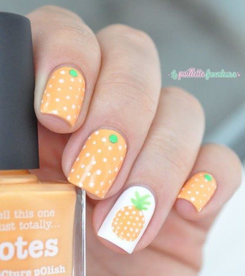 light orange nail design with pineapples