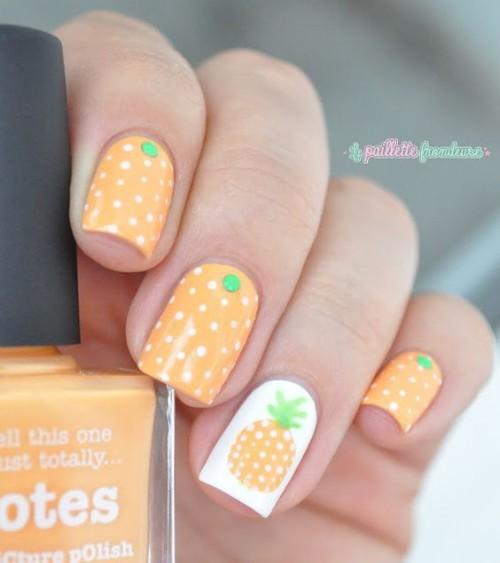 light orange nail design with pineapples