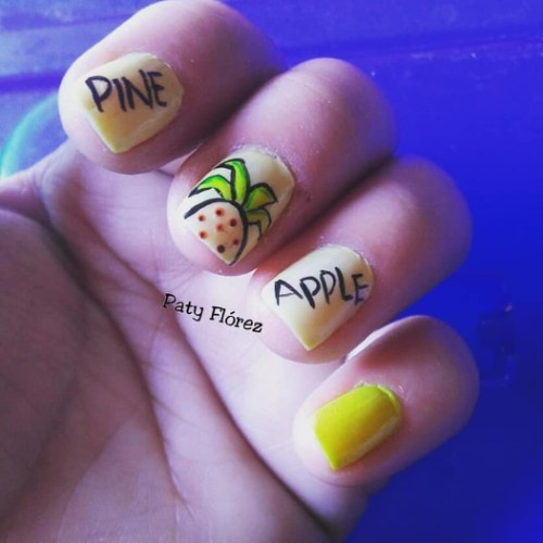 light yellow nails with pineapples