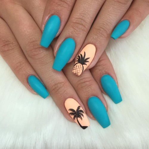 matte blue nail design with palmtree and pineapple