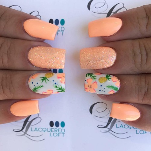 neon peach nails with pineapple fruit