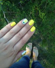 neon yellow nails with pineapple