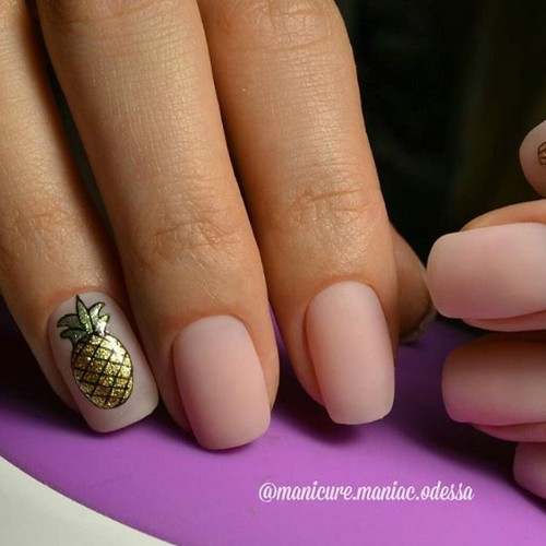 nude matte nails with golden glitter pineapple