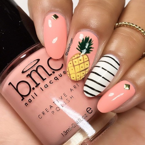 nude pink nail art with pineapple
