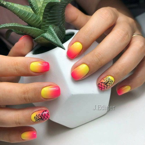 orange and yellow nails with black pineapple silhouette
