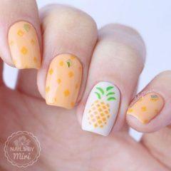 orange nail design with pineapple