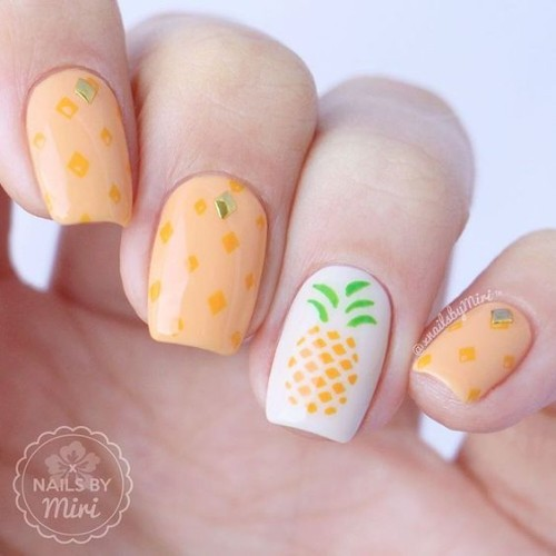 orange nail design with pineapple