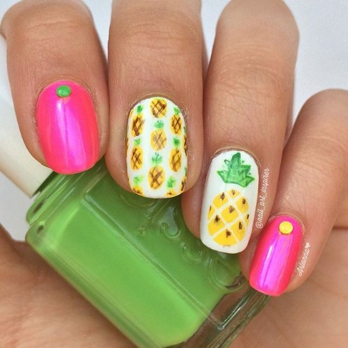 pink and white nails with pineapples