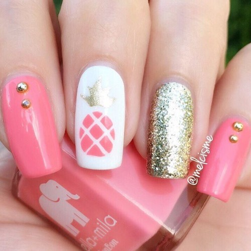 pink nails with pineapple and golden accent nail